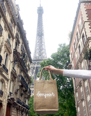 Medium Bonjour Reusable Gift Tote In Black Font In Front of Eiffel Tower | The Little Market