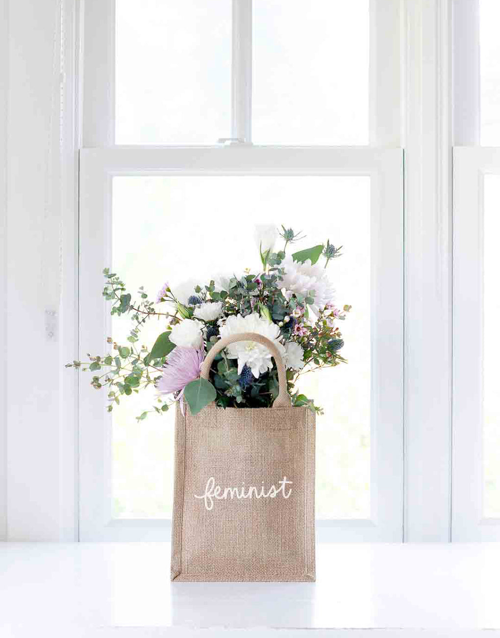 Small Feminist Reusable Gift Tote In White Font With Flowers Inside | The Little Market