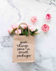 Small Good Things Come In Small Packages Reusable Gift Tote In Black Font With Flowers Inside | The Little Market