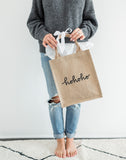 Medium Hohoho Reusable Gift Tote In Black Font Being Held | The Little Market