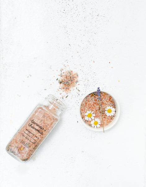 Lavender And Chamomile Scented Soaking Salt Spilled And In Small Bowl With Flowers | The Little Market