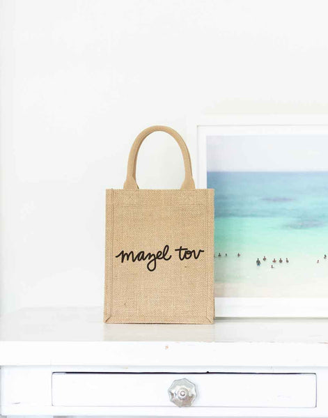 Small Mazel Tov Reusable Gift Tote In Black Font On Desk | The Little Market