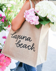 Large Laguna Beach Reusable Shopping Tote In Black Font With Flowers | The Little Market