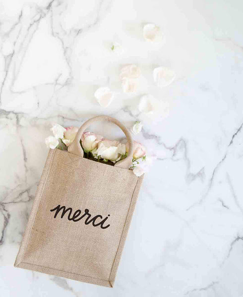 Medium Merci Reusable Gift Tote In Black Font With Flowers Inside | The Little Market