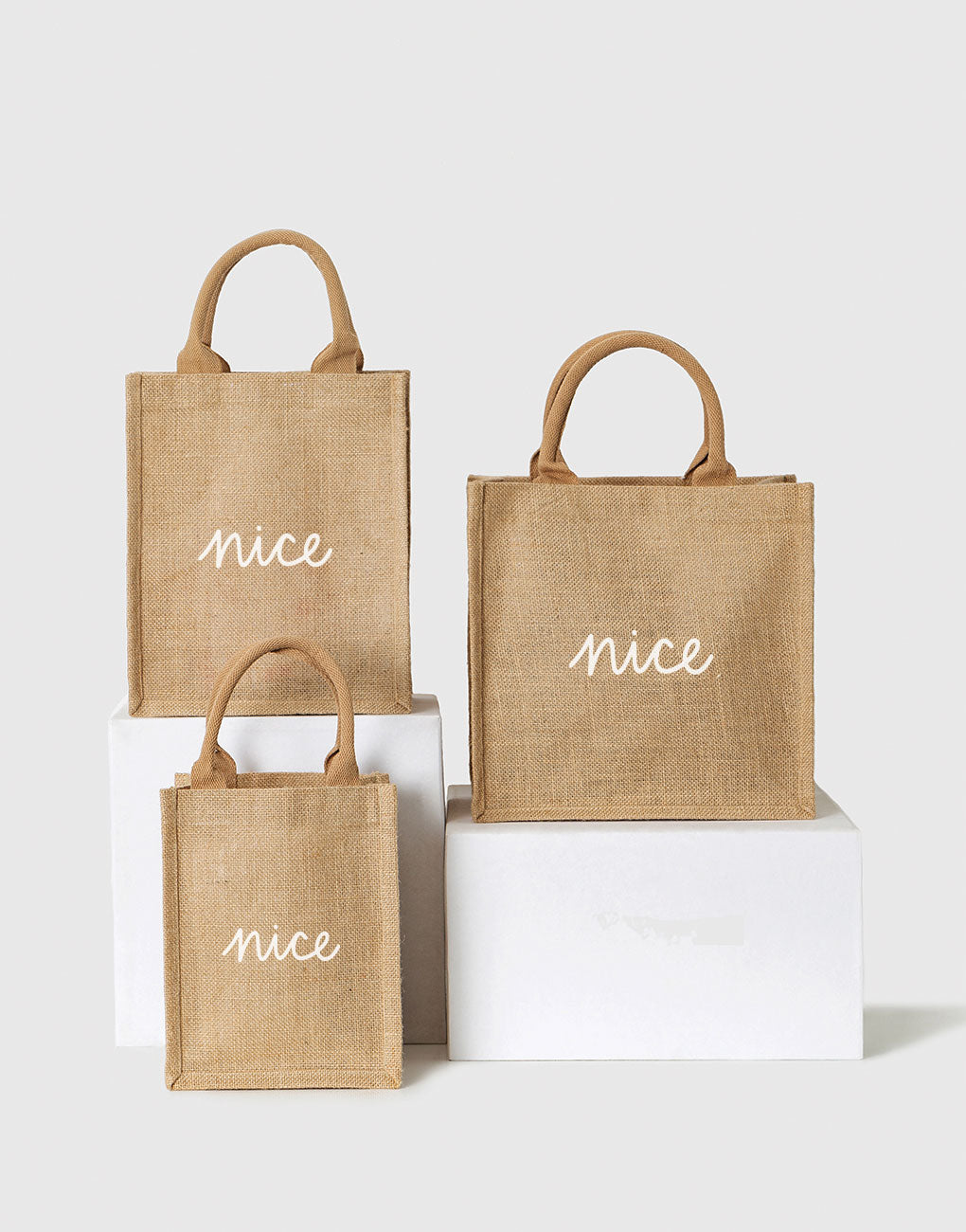 Small, Medium, And Large Nice Reusable Gift Totes In White Font | The Little Market