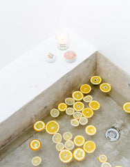 Orange Scented Candle, Bath Bomb, And Soaking Salt In Small Bowl | The Little Market