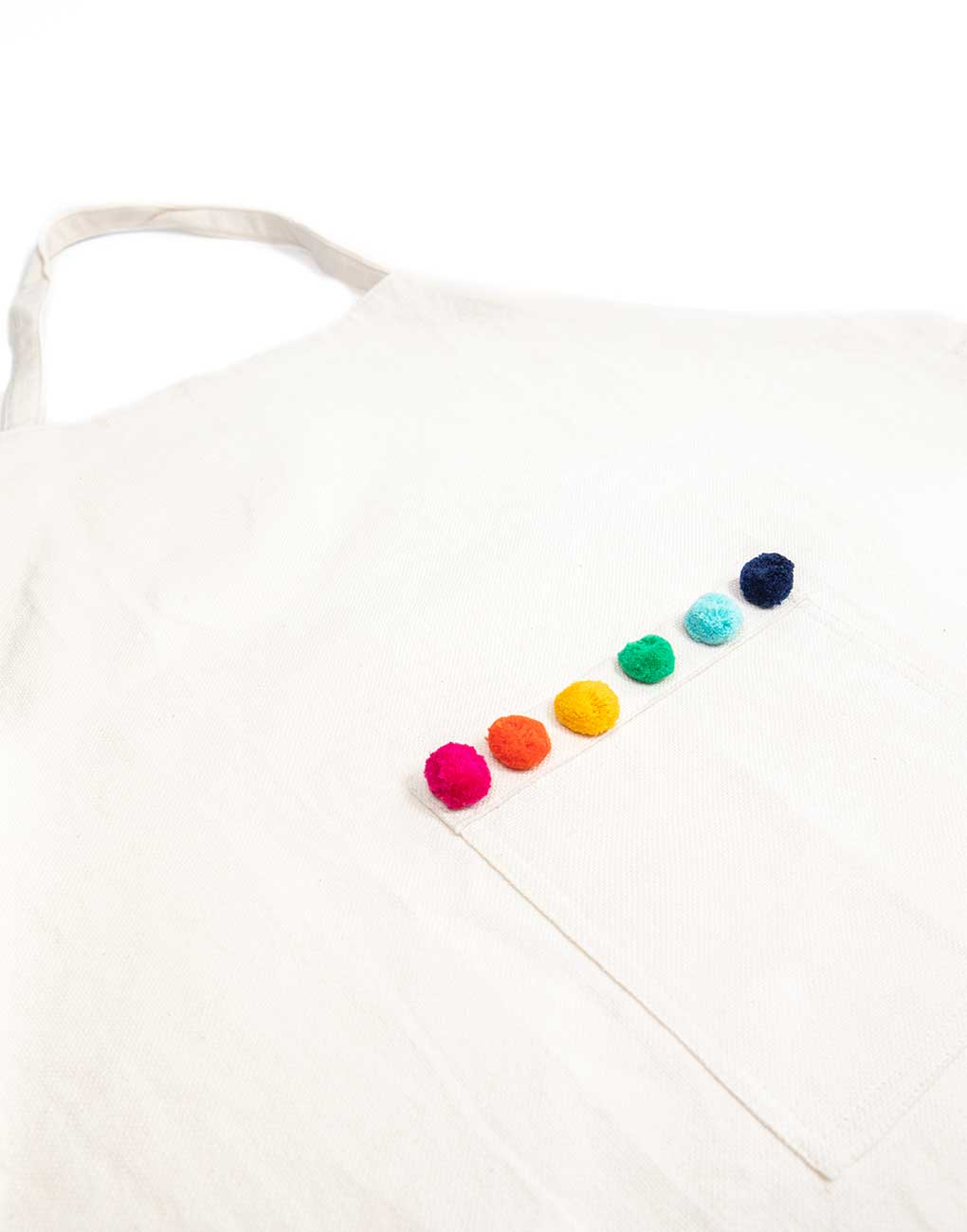 Rainbow Pom Poms Kids Apron Close Up | The Little Market