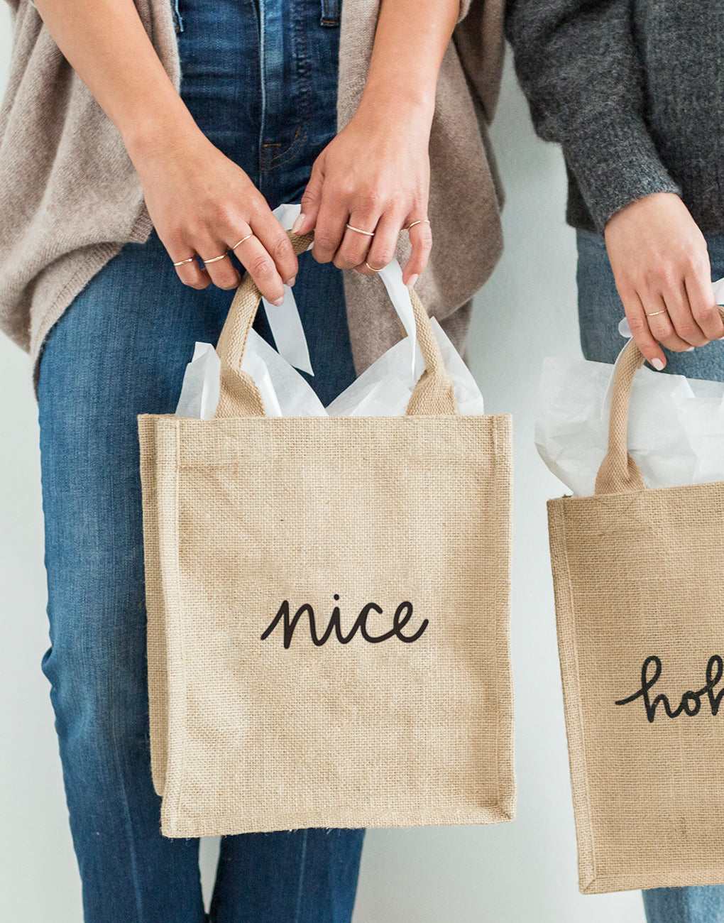 Medium Nice Reusable Gift Tote In Black Font Being Held | The Little Market