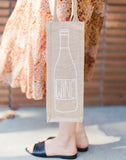 Lauren Conrad Design Wine Reusable Wine Tote In White Design Being Held | The Little Market