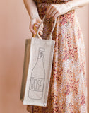 Lauren Conrad Design Rosé Reusable Wine Tote In Black Design Being Held | The Little Market