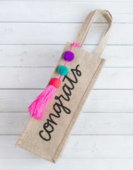 Style 1 Congrats Reusable Wine Tote In Black Font With Pom Poms | The Little Market