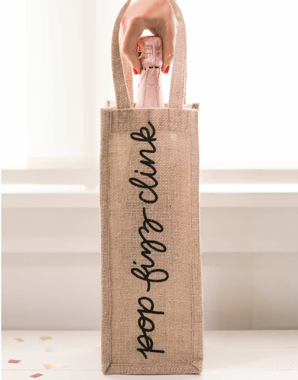 Pop Fizz Clink Reusable Wine Tote In Black Font With Bottle Inside | The Little Market