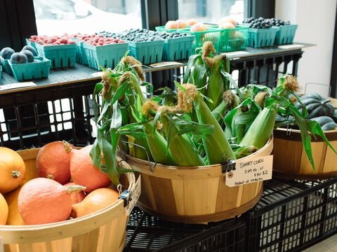 Fresh fruit, squash, berries, and corn at Legacy Greens grocery store in downtown Kitchener