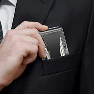 Storus Smart Wallet being placed into a front suit jacket pocket