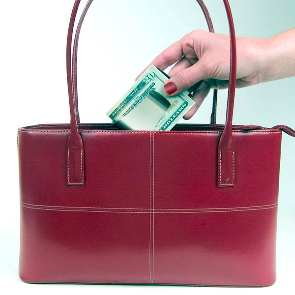 Storus® Smart Money Clip® shown being placed into a purse