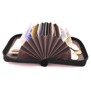 Storus Smart Accordion Wallet open and fanned filled with money and cards