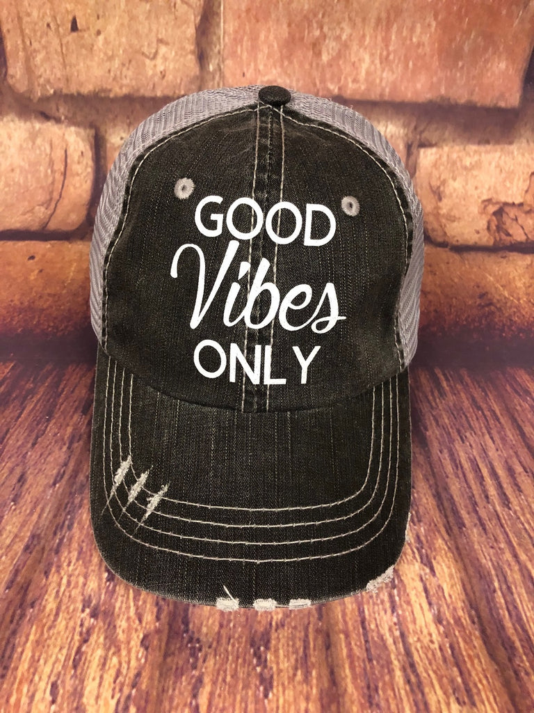 White glitter Good Vibes Only design on a Distressed mesh back Grey Trucker Cap