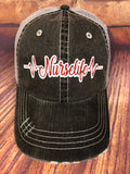 "White/Red Glitter "" Nurselife "" design on Distressed Grey Trucker Cap"