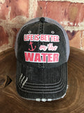 "Coral/White Glitter ""Life Is Better On The Water""  design on Distressed Grey Trucker Cap"