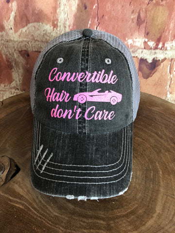 "Neon Pink Glitter "" Convertible Hair Don't Care "" design on Mesh Back Grey Trucker Cap"