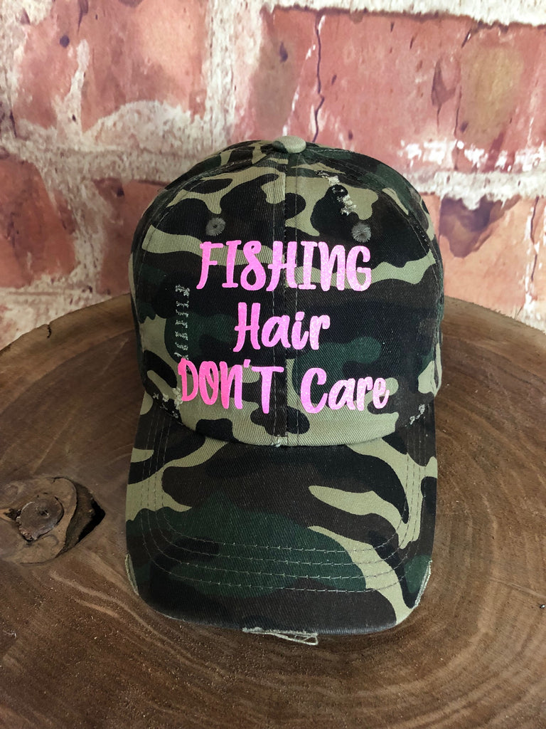 "Neon Pink Glitter "" Fishing Hair Don't Care "" design on Distressed Green Camo Baseball Cap"