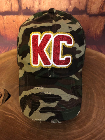 Red/White/Gold glitter vinyl KC on Distressed Green Camo Baseball Cap
