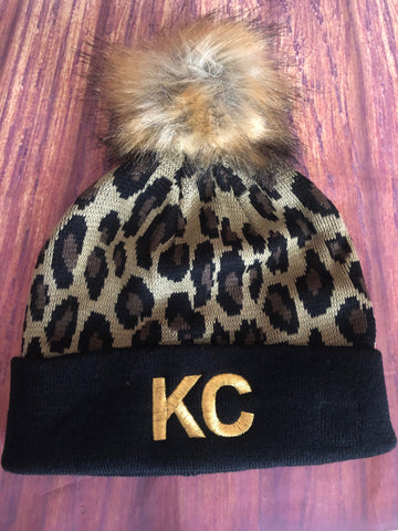 Gold Metallic Embroidered KC on Black/Leopard Pom Pom Beanie Hat