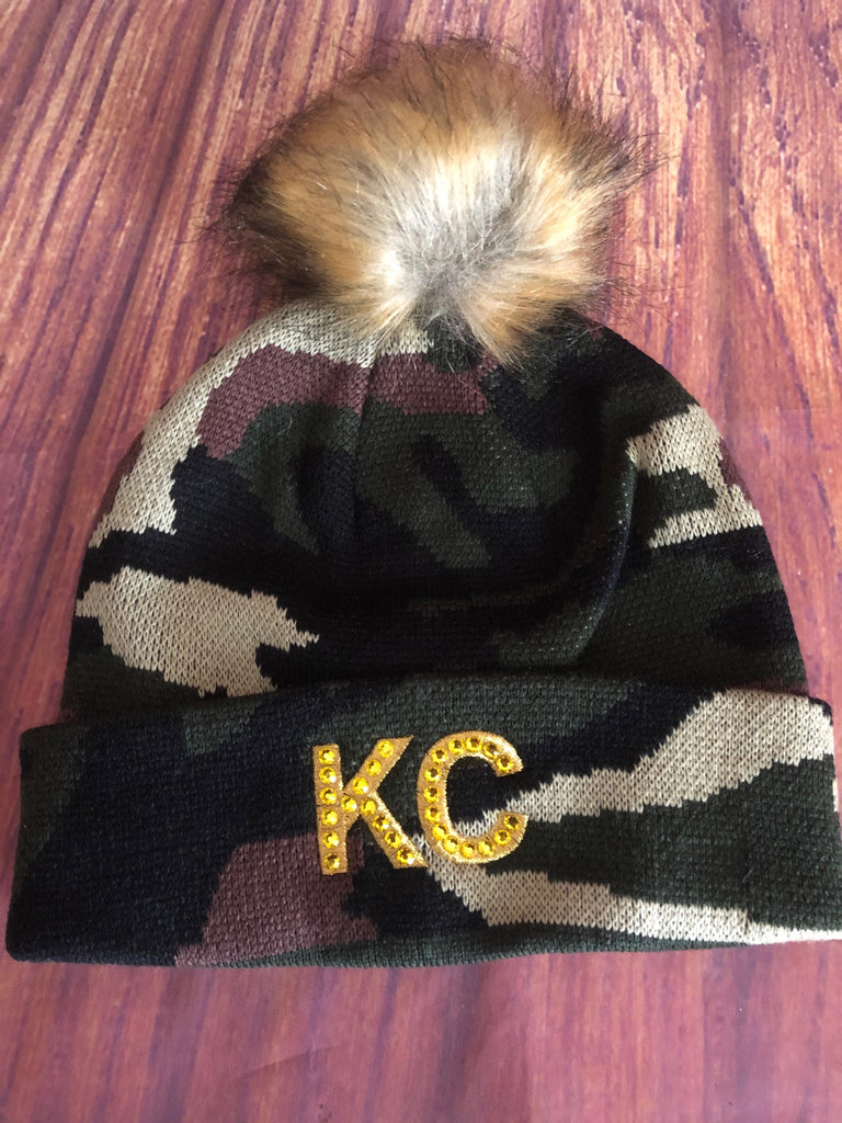 Gold Swarovski Crystals on Gold Metallic Embroidered KC on Green Camo Pom Pom Beanie Hat