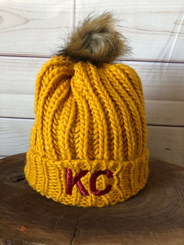 Red Metallic Thread KC on Mustard Yellow Cable Knit Fleece Lined Stretch Pom Pom Beanie Hat