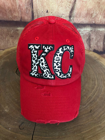 Black/White glitter Leopard print KC letters on Distressed Red mesh back Trucker Cap