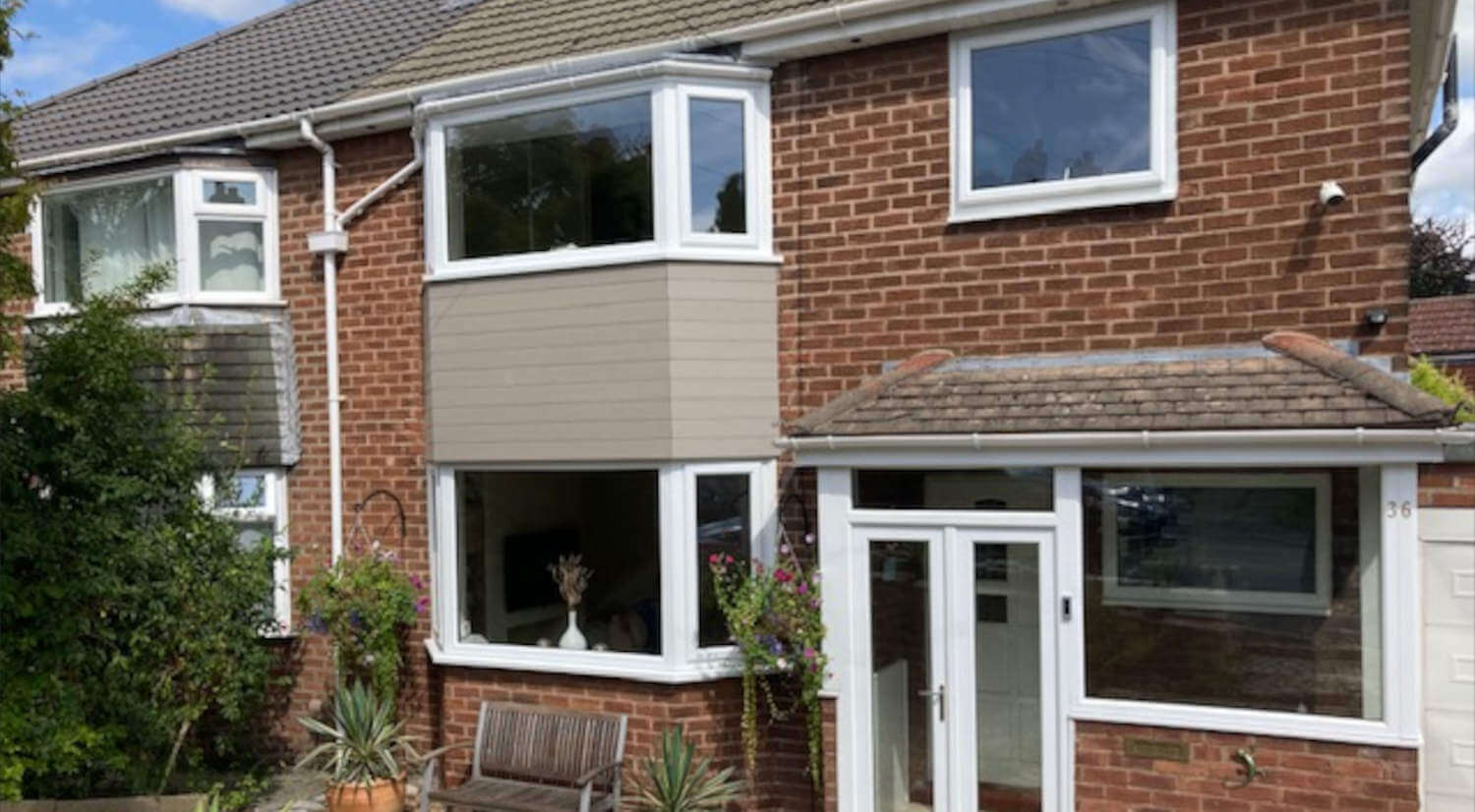 front of house featuring composite cladding on bay windows