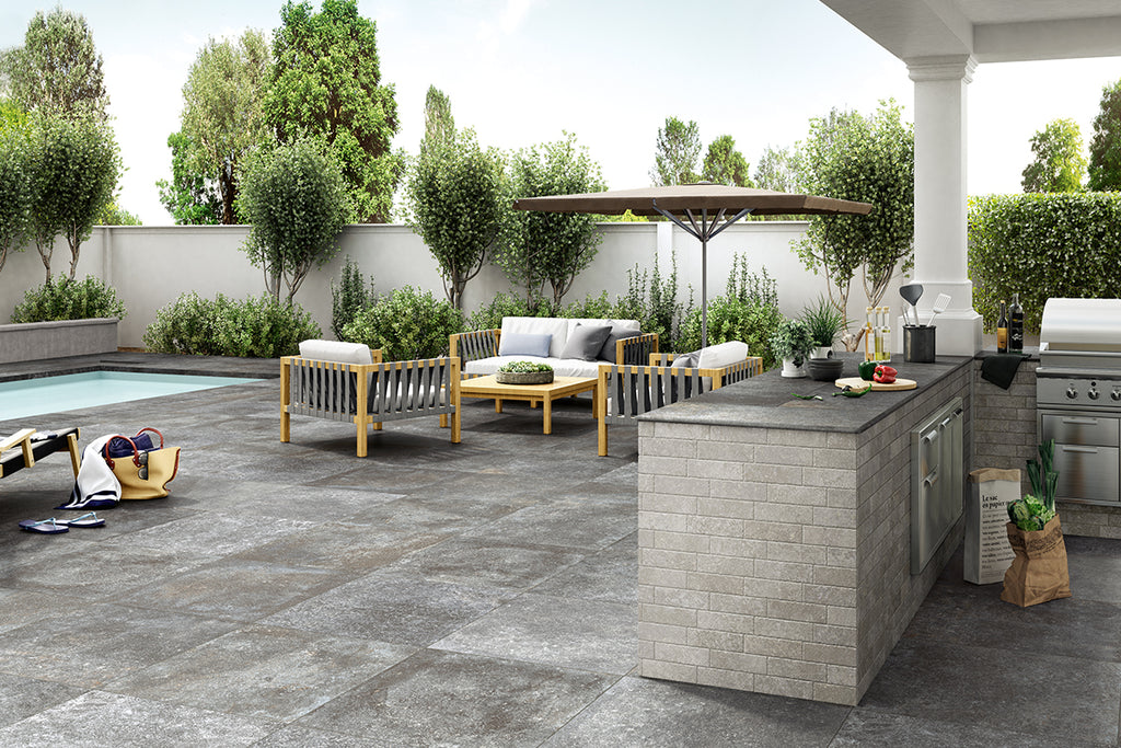 Silver stone effect porcelain paving used for an outdoor kitchen