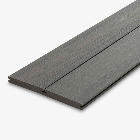 Capped solid composite deck board