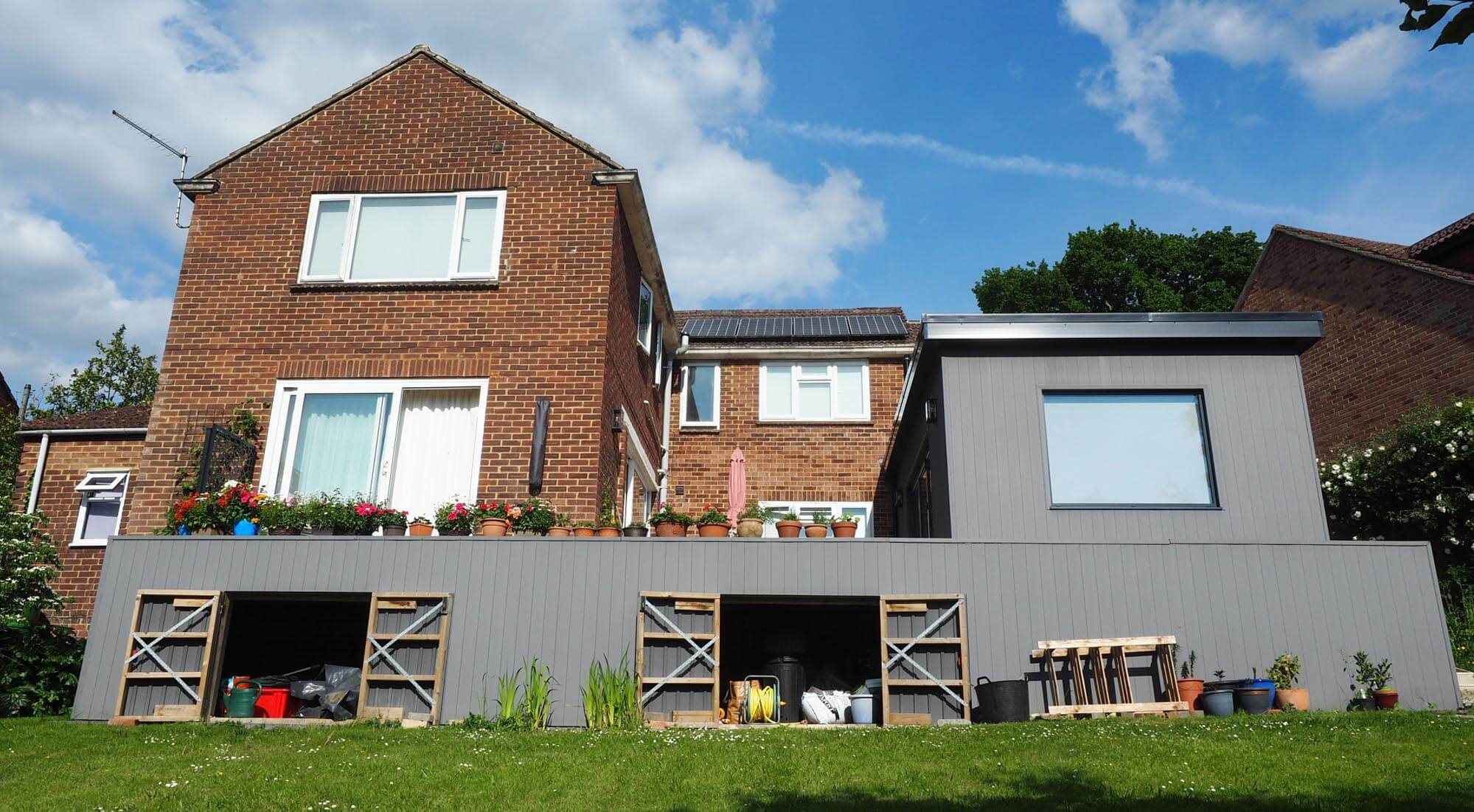 Studio and extended patio storage cladding
