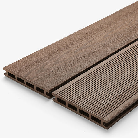 Structured composite deck board