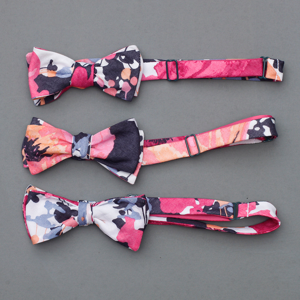 bright floral bow tie in navy, magenta, peach, coral, periwinkle, & white