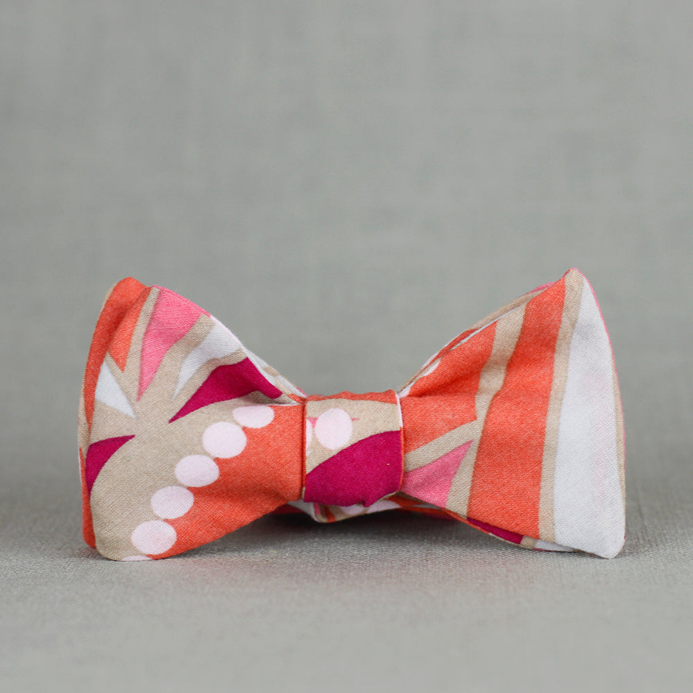 fuchsia, bubblegum pink, orange, and khaki bow tie
