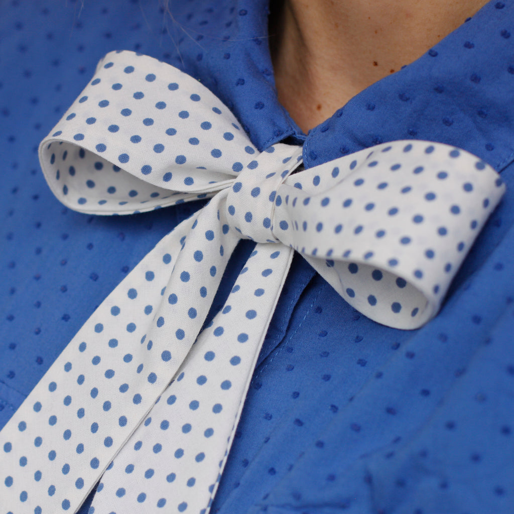 white & blue polka dot pussy bow