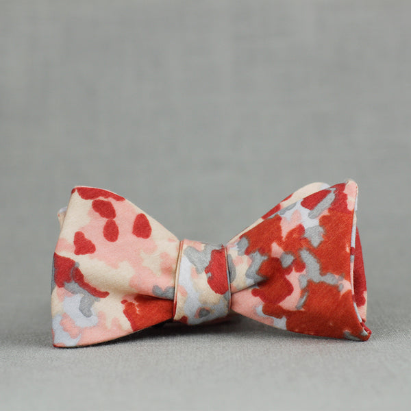 peach, coral, red, and grey abstract floral bow tie