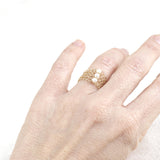 peal ring design in gold on hand