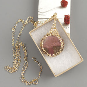 Large round Rhodonite pendant necklace, nested in gold wire crochet - Yooladesign