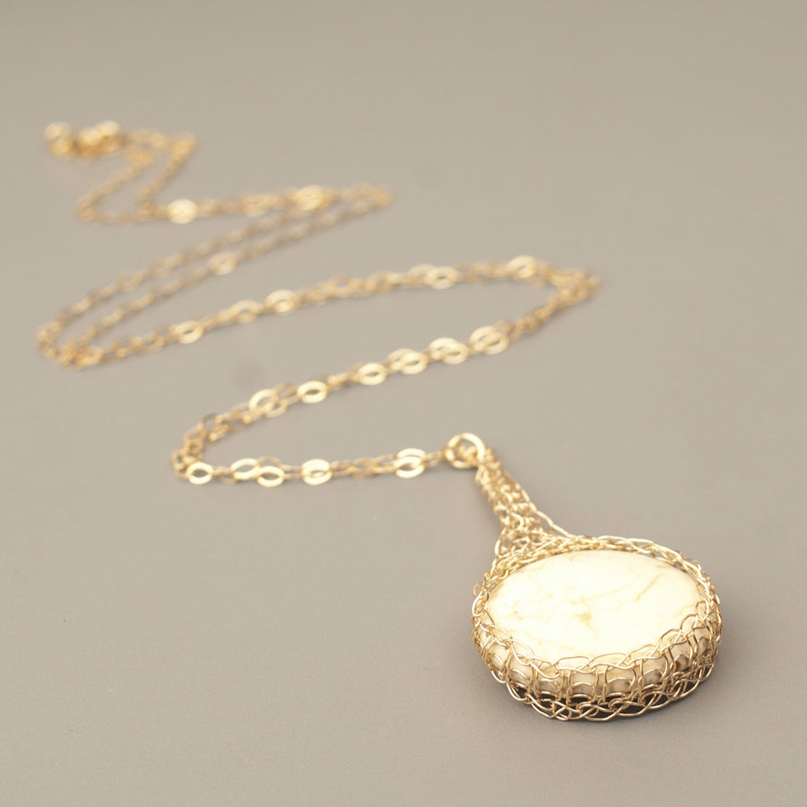Round IVORY Howlite pendant necklace, nested in gold wire crochet - Yooladesign