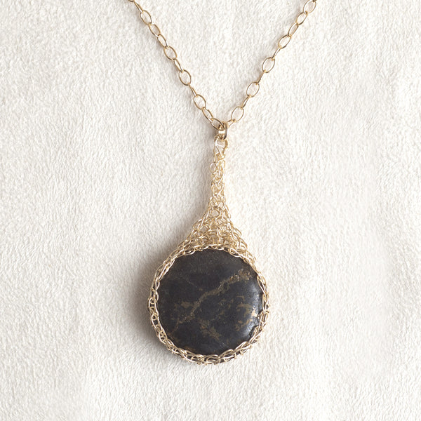 Pyrite pendant in a gold cabochon