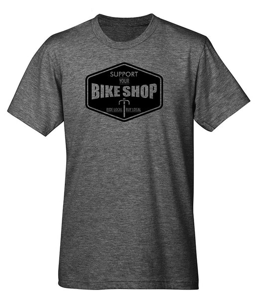 "A heather t-shirt with a graphic of a bicycle and the text that reads ""Support your bike shop. Ride local buy local."""