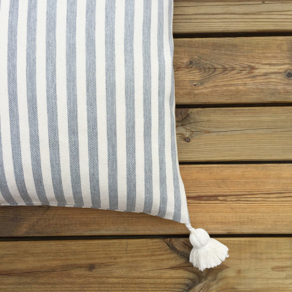STRIPED POM POM CUSHION