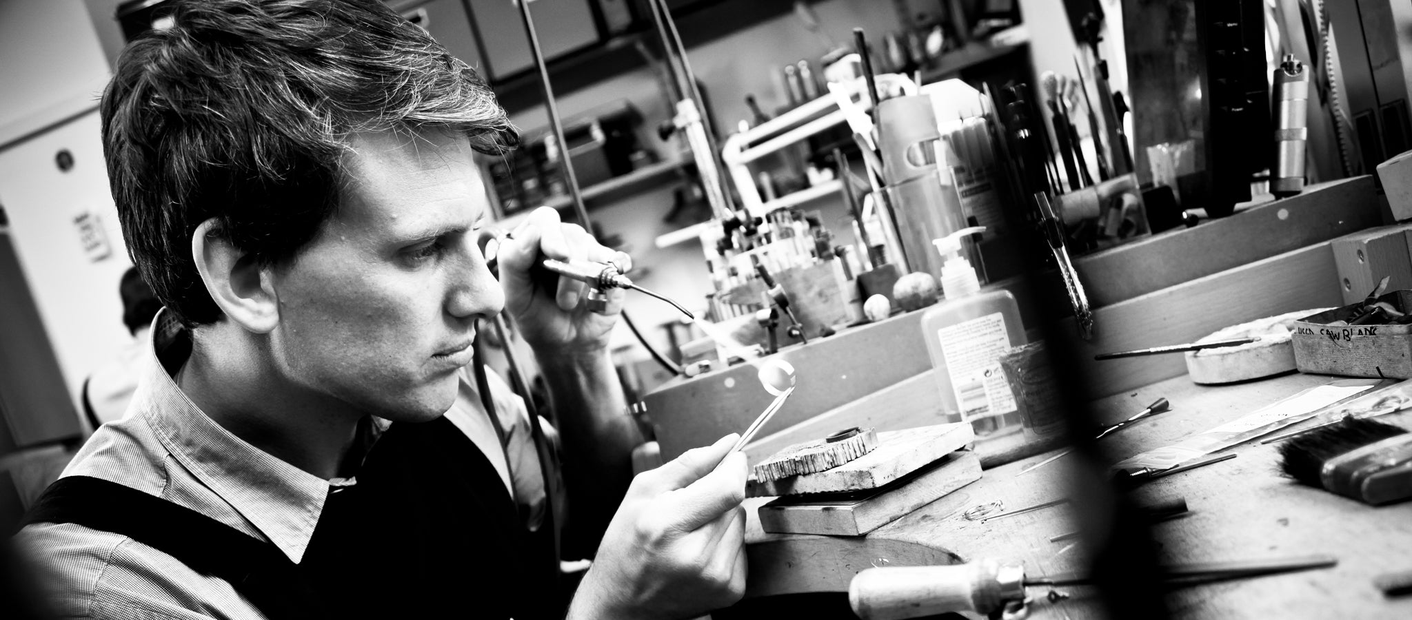 James Newman hand crafting jewellery at his jewellers bench in his Birmingham Jewellery Quarter workshop.