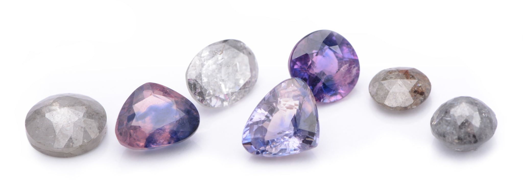 A selection of unique, rosecut and brilliant cut, grey and salt and pepper diamonds and lilac and purple spinels.