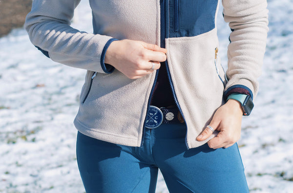 The Hunt Buckle Belt being worn by a woman with a jacket on in the snow.