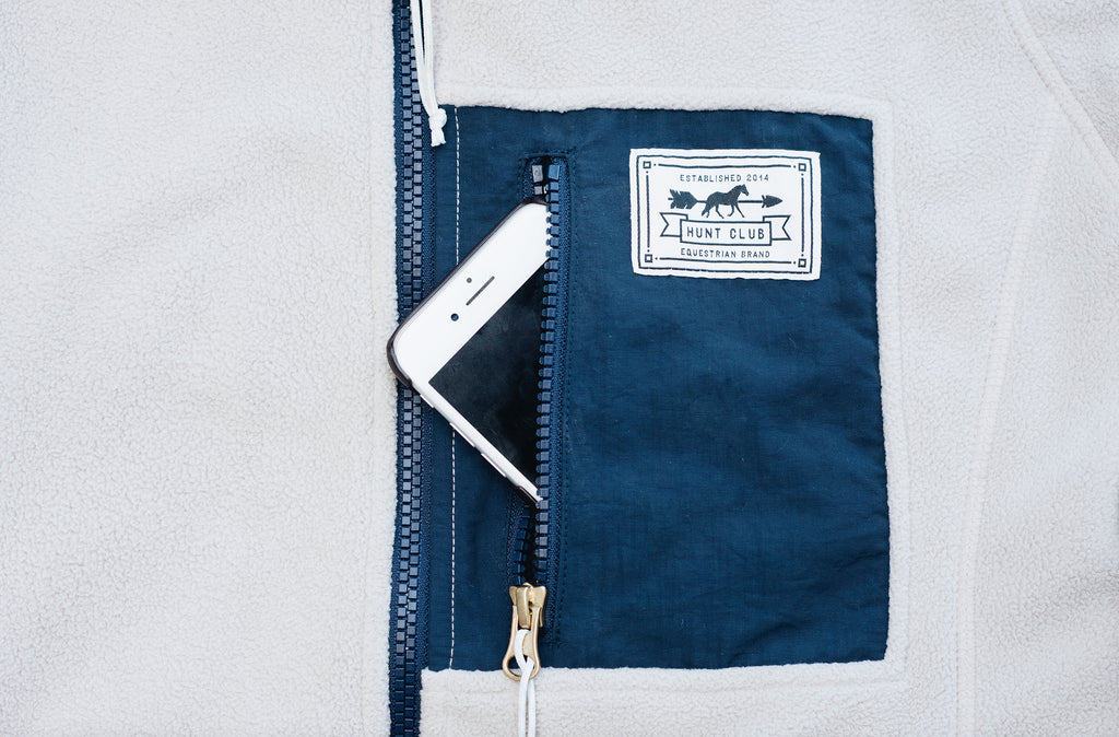 Close-up of the phone pocket on Hunt Club's oatmeal and navy fleece jacket.