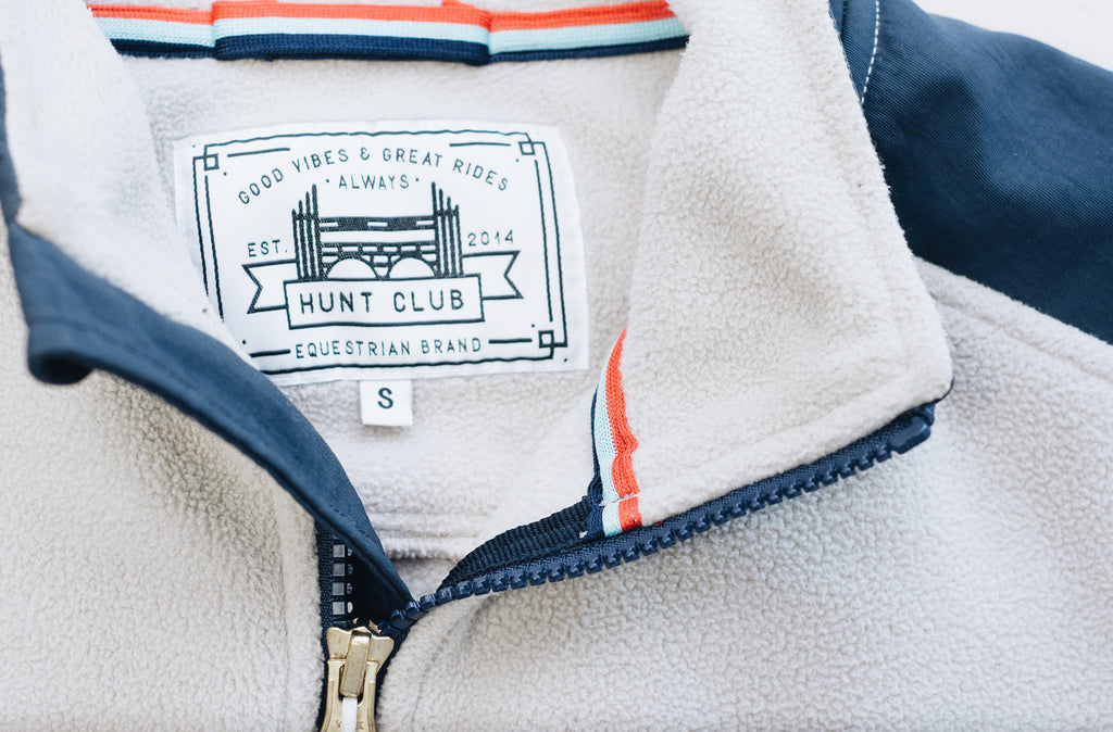 Close-up detail of Hunt Club's oatmeal colored fleece jacket.